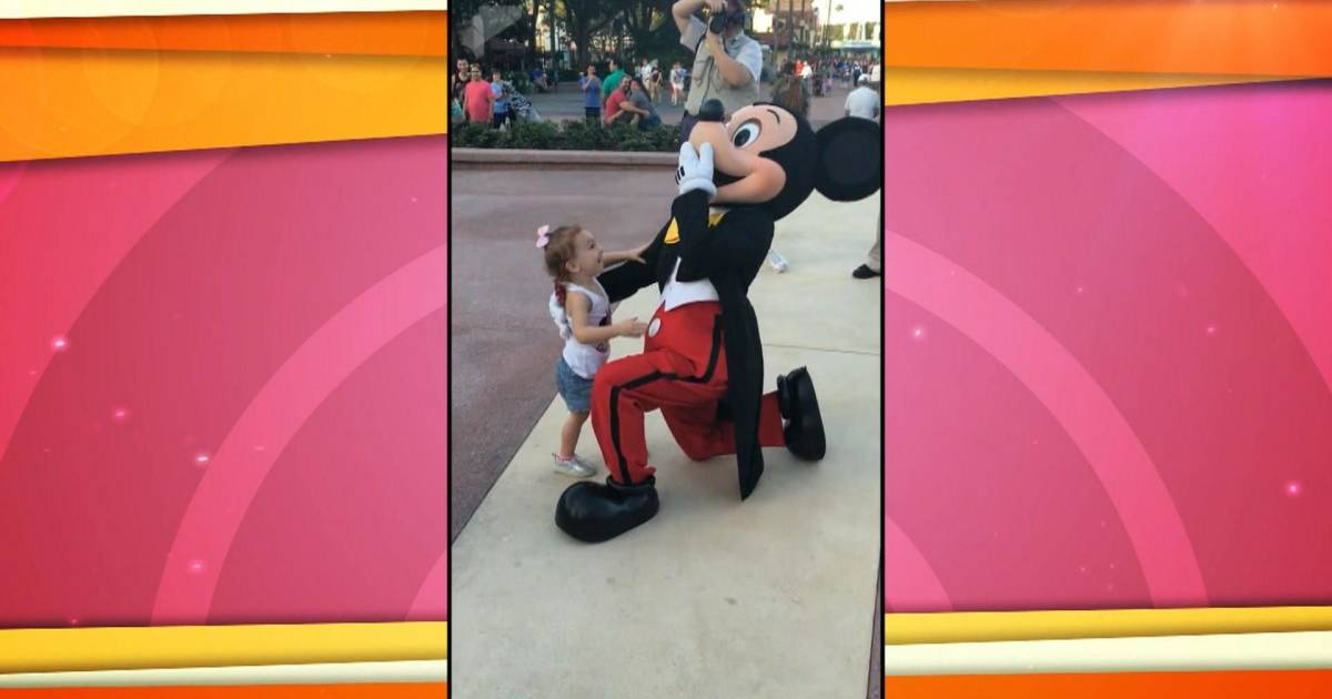Sweet 2-year-old starstruck meeting Mickey Mouse