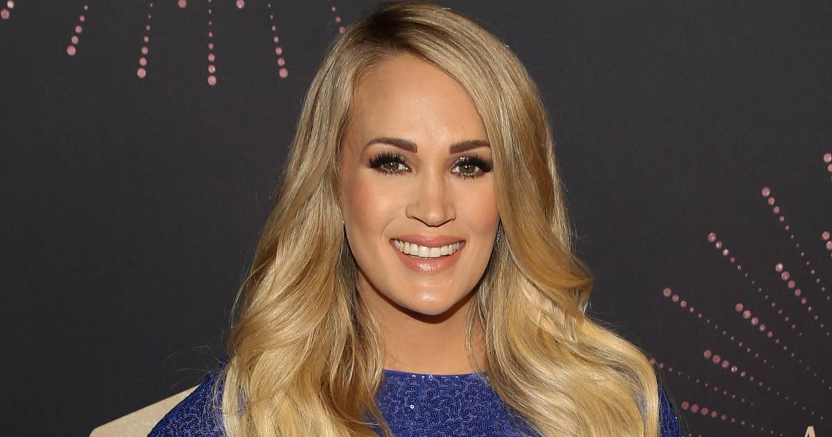 Pregnant Carrie Underwood can't tie her own shoes! See her teamwork solution