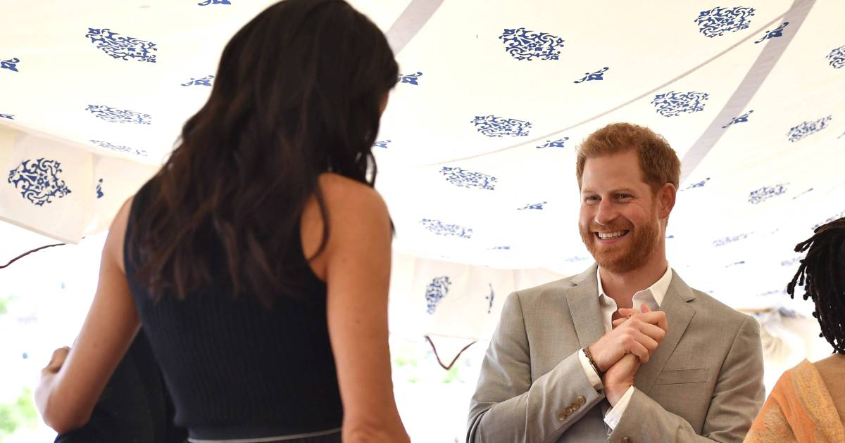 Watch Prince Harry fix Duchess Meghan's hair on a windy day in London