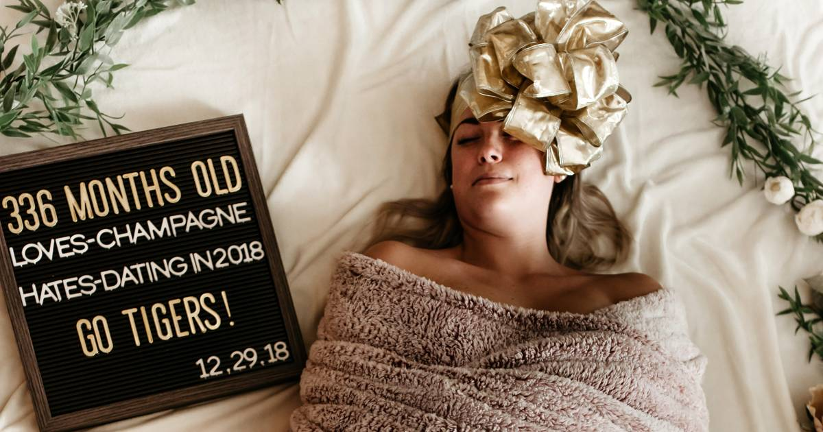 Woman Poses In Swaddle For Funny Birthday Photo
