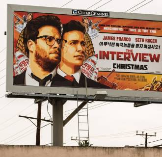 Image: A billboard for the film 'The Interview' is displayed in Venice, California