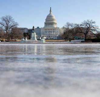 Image: The reflecting pool in front of the U.S. Capitol building is frozen over