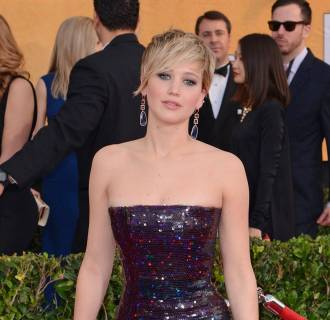 Image: Actress Jennifer Lawrence arrives at the 20th Annual Screen Actors Guild Awards