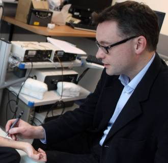 Image: Dr. Andrew Clark of Cambridge University, right, performs a skin prick test, which is used to diagnose food allergies.
