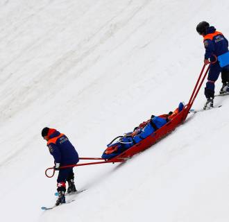 Image: Injured Tyler Walker of United States is stretchered off the mountain after crashing
