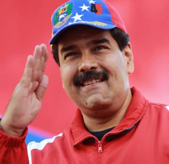 Image: Venezuelan President Nicolas Maduro salutes during a rally at the presidential palace in Caracas on Sunday.