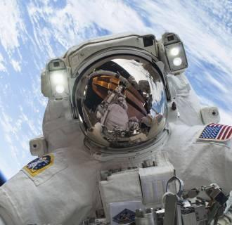 Image: Astronaut Mike Hopkins participates in a spacewalk.