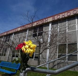 Image: Flowers are seen outside the Franklin Regional High School in Murrysville, Pa.
