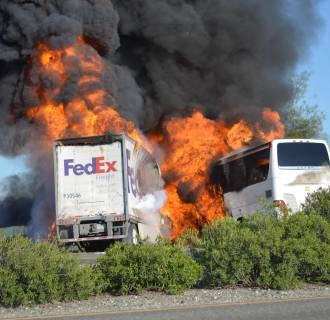 Image: Scene of crash between tour bus and FedEx tractor-trailer in California on April 10