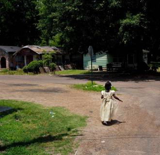 Image: Dialia Wooten walks home from church in Baptist Town, Mississippi