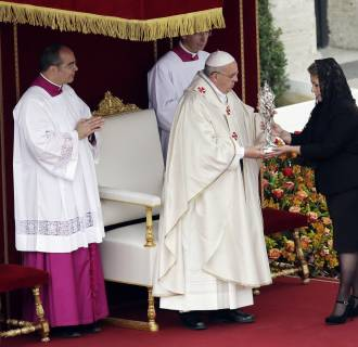 Image: Pope Francis receives the relic of Pope John Paul II from Floribeth Mora