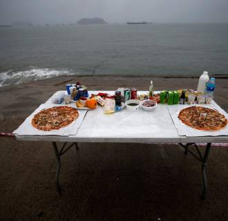Image: Pizzas are placed among other food offerings on altar dedicated to missing and dead passengers on board capsized Sewol ferry, at a port in Jindo