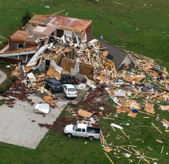 Image: This aerial photo shows a home damaged by a tornado near Fayetteville, Tenn., on Wednesday, April 30, 2014.