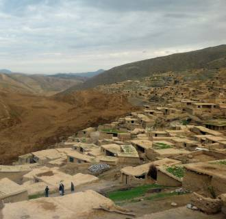 Image: Villagers look at the path of a landlside in Aabe Barik, Afghanistan, on May 3.