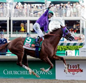 Image: Victor Espinoza rides California Chrome to a victory during the 140th running of the Kentucky Derby horse race at Churchill Downs