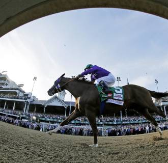 Image: Jockey Victor Espinoza rides California Chrome to win the 140th running of the Kentucky Derby