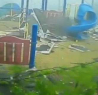 Image: The slide was one of the few things that survived as a tornado hit a church playground in Tupelo, Miss.