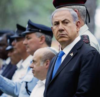 Image: Israel's PM Netanyahu attends ceremony marking Fallen Soldiers Memorial Day held on Mount Herzl Military Cemetery in Jerusalem