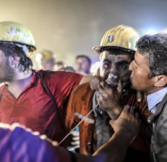 Image: A miner celebrates with his father
