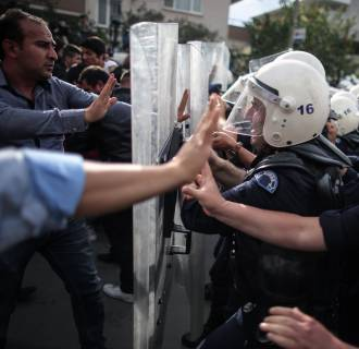 Image: Riot police try to stop protesters who were attacking the offices of Prime Minister Recep Tayyip Erdogan's Justice and Development Party