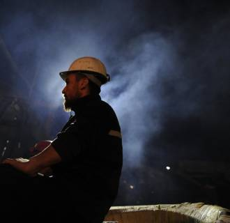 Image: A Turkish miner at the entrance of the coal mine in Soma