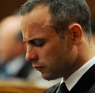 Image: Oscar Pistorius cries during his ongoing murder trial
