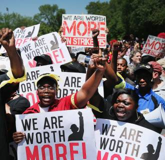 Image: Fast food workers and activists demonstrate outside the McDonald's corporate campus on May 21, for a higher wage