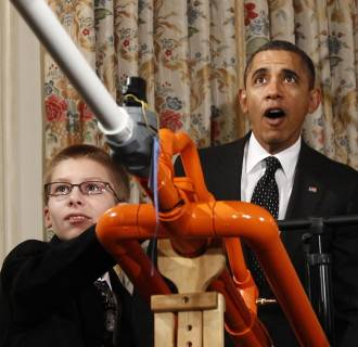 Image: U.S. President Obama reacts as Hudy launches a marshmallow from his Extreme Marshmallow Cannon during the second White House Science Fair in Washington