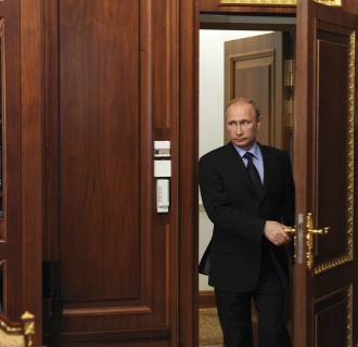 Image: Russian President Putin arrives for a meeting in Moscow's Kremlin