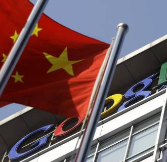 Image: A Chinese national flag flies in front of Google China's headquarters in Beijing