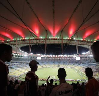 Image: Fluminense fans watch a Brazilian championship soccer match against Sao Paulo in Maracana stadium in Rio de Janeiro