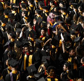 Image: Graduates celebrate during Savannah College of Art and Design's 2014 Commencement on May 31 in Savannah, GA