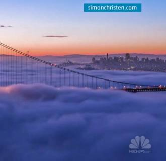 Fog rolls in past the Golden Gate Bridge in San Francisco