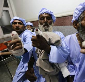 Image: Men show their fingers after the ink-stained part of their fingers were cut off by the Taliban after they took part in the presidential election