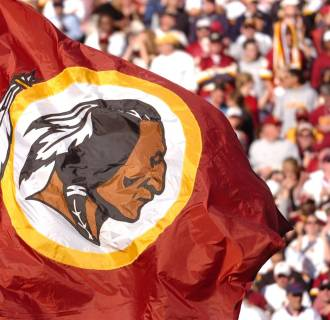 Image: The Washington Redskins flag is waved