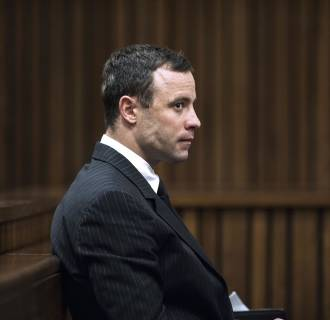 Image: Oscar Pistorius sits in the dock during his murder trial
