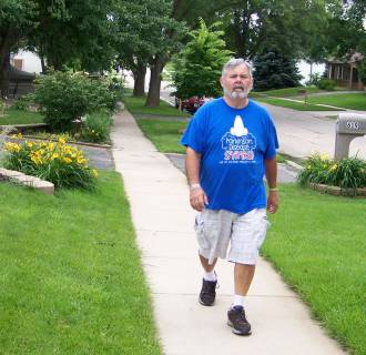 Image: Parkinson's patient and activist John Krumbholz of Cedar Rapids, Iowa takes a walk