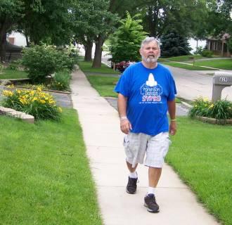 Image: Parkinson's patient and activist John Krumbholz of Cedar Rapids, Iowa takes a walk