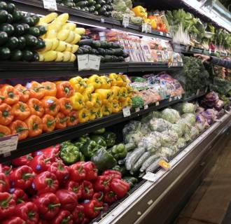 Image: File photo of a customer shopping for fresh produce at the Whole Foods grocery story in Ann Arbor