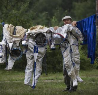 Image: An employe of Russian Space Training Center hangs out to dry space suits
