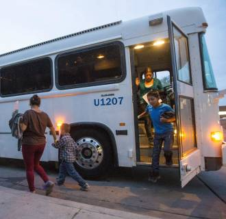 Image: Migrants are released from ICE custody at a Greyhound Bus station in Phoenix, on May 28, 2014.