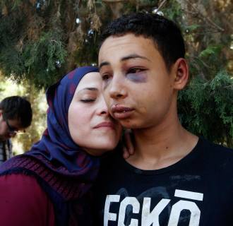 Image: Tariq Khdeir is greeted by his mother after being released from jail in Jerusalem