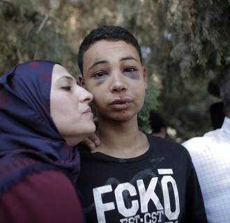 Image: Tariq Abu Khder (C), a Palestinian-US teenager who was allegedly beaten during police custody