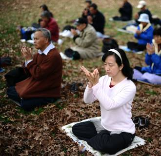 Image: Members of Falun Gong spiritual movement meditate at the Lafayette Park in front of the White House in Washington, DC, on Nov. 20, 2011.