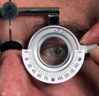 Image: A man wearing eye test glasses