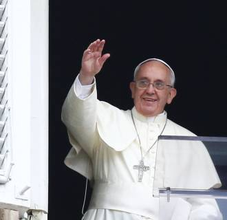 Image: Pope Francis waves as he leads his Sunday Angelus prayer in Saint Peter's square at the Vatican