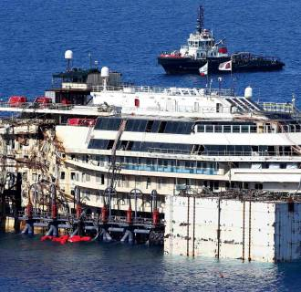 Image: The cruise liner Costa Concordia is seen at Giglio harbour, Giglio Island