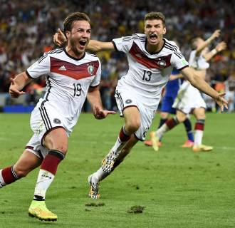 Image: Germany's Goetze celebrates near Mueller after scoring a goal during extra time in their 2014 World Cup final against Argentina at the Maracana stadium in Rio de Janeiro