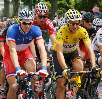 Image: Lotto-Belisol team rider Gallopin of France wears the race leader's yellow jersey during the 10th stage of the Tour de France cycle race