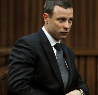Image:South African Olympic and Paralympic sprinter Oscar Pistorius sitting in the dock during his murder trial in the North Gauteng High Court in Pretoria on July 1.